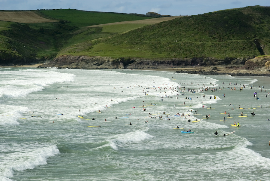 Surfers at Polzeath Beach